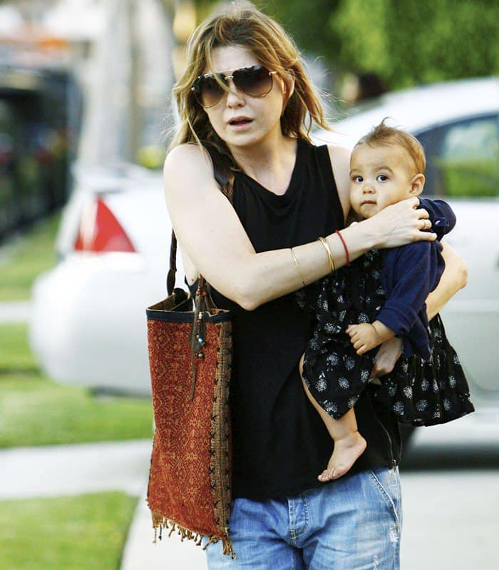 Ellen Pompeo carrying a bohemian JADEtribe fringe tote