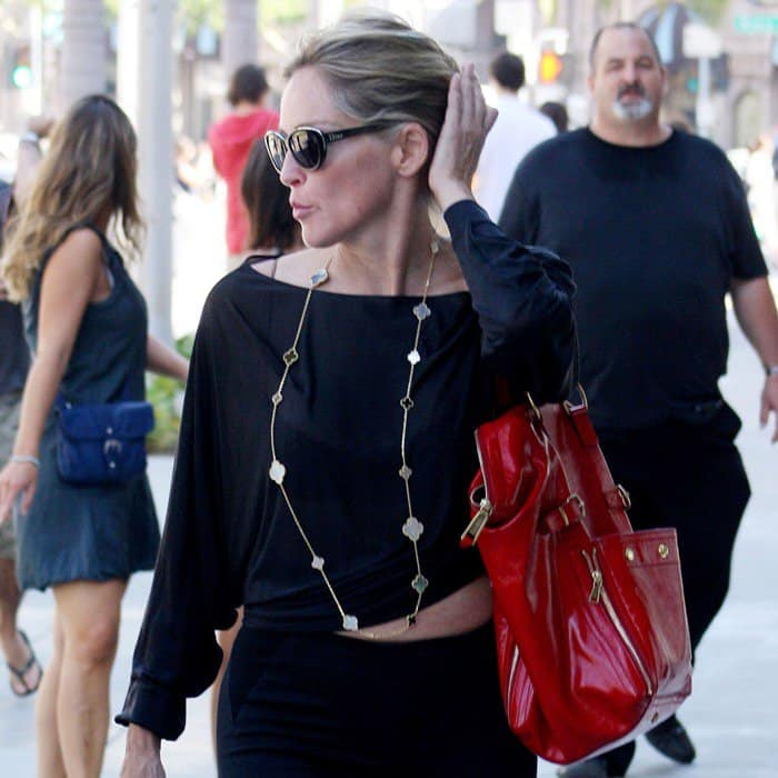 Sharon Stone toting a red bag