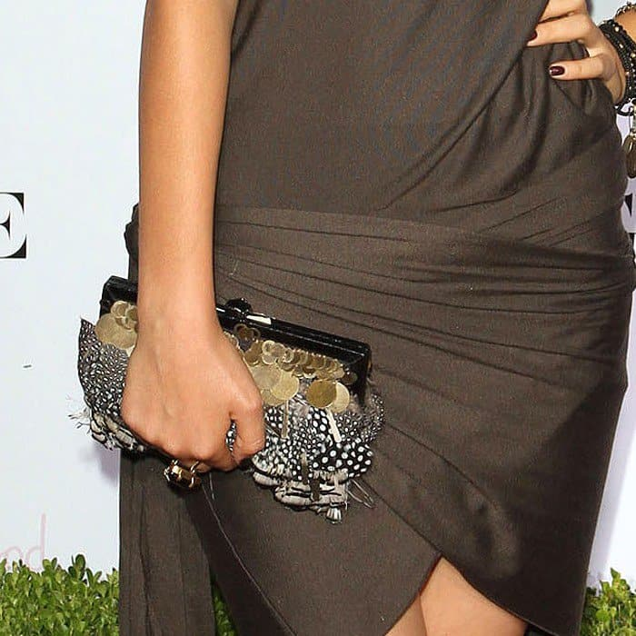 Victoria Justice carries Kotur 'Fino' snakeskin trim feather clutch