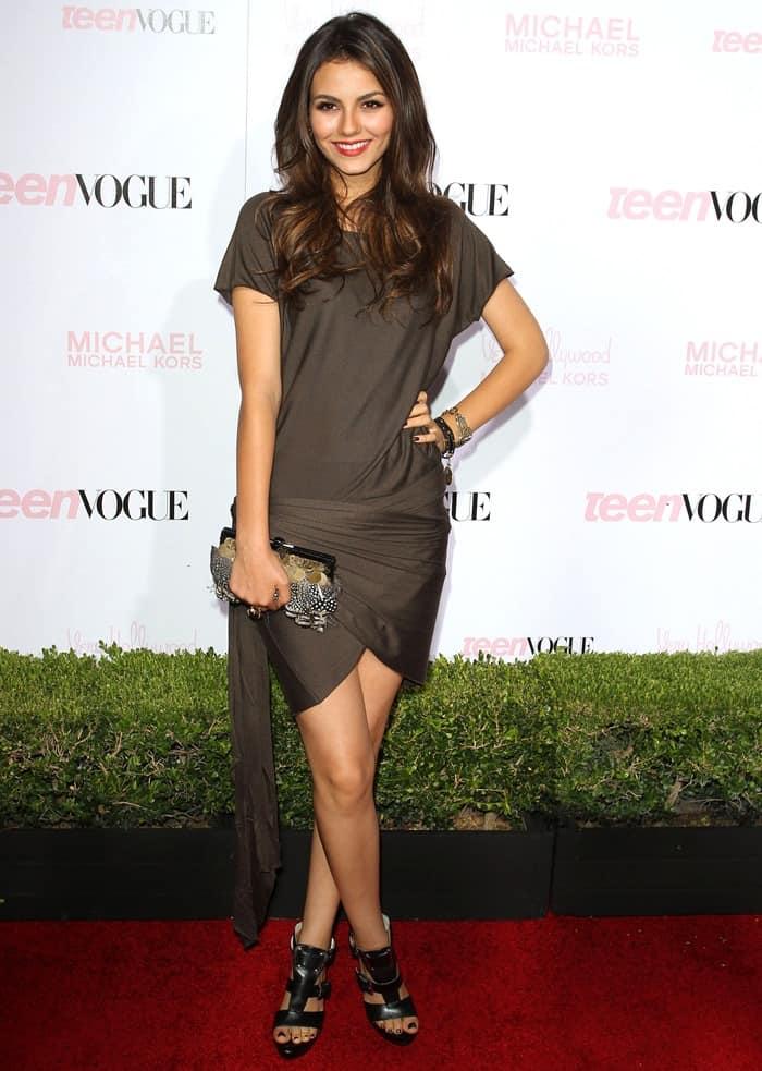 Victoria Justice rocking a grey short-sleeved wrap skirt dress and black gladiator platform sandals
