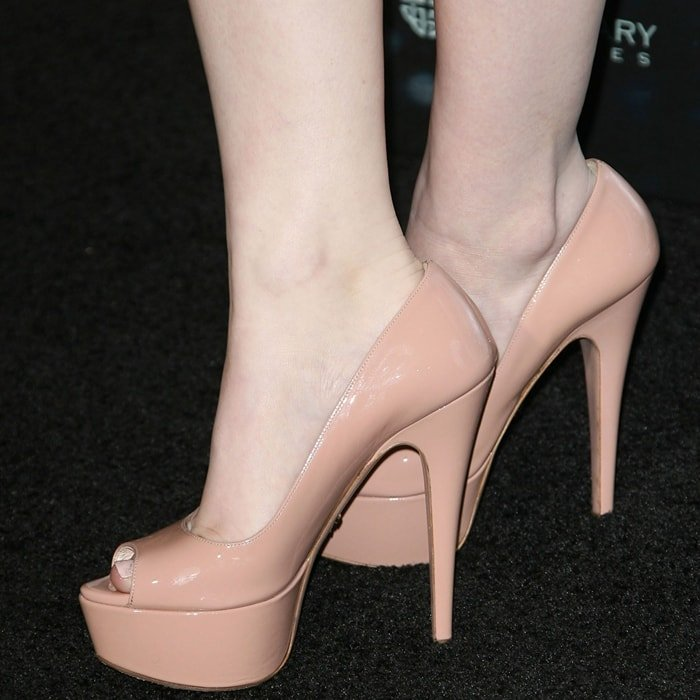 Emily Browning shows off her size 6 (US) feet in high heels