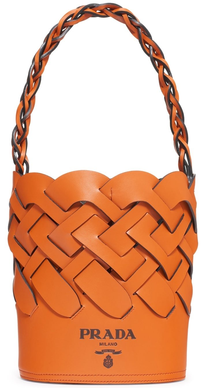 A woven design gives a distinctive look to a bucket Prada bag crafted in Italy of exceptionally soft and lustrous calfskin with a tethered zip pouch inside