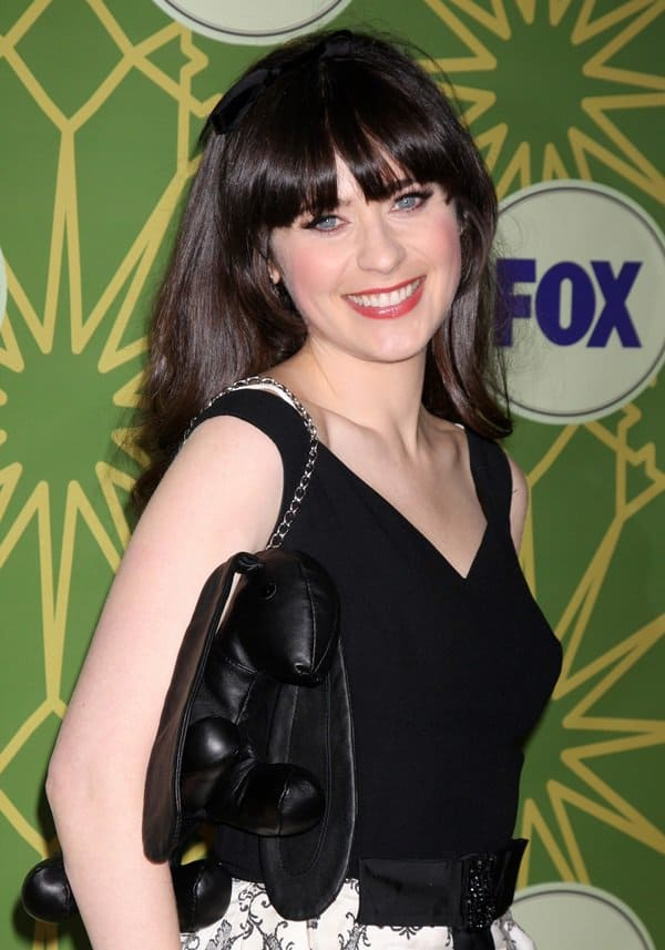 Zooey Deschanel toting a funny-looking leather purse by Mandy Coon