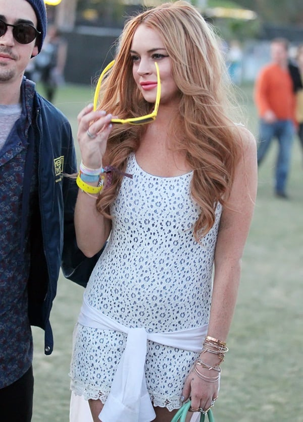 Lindsay Lohan in a lace dress and Marc Jacobs sunglasses