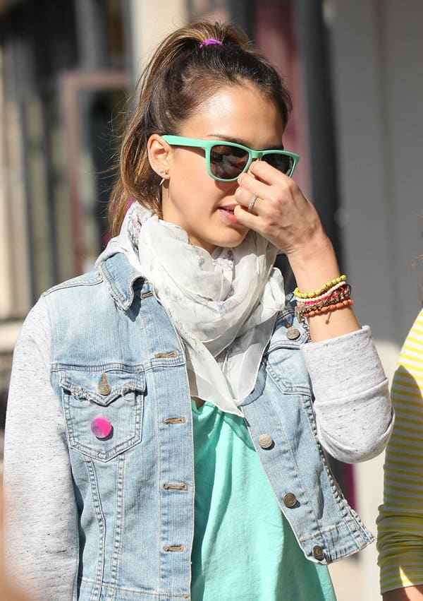 Jessica Alba in a mint green top underneath a denim jacket