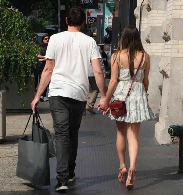 Lea Michele and boyfriend Cory Monteith holding hands while shopping in Manhattan