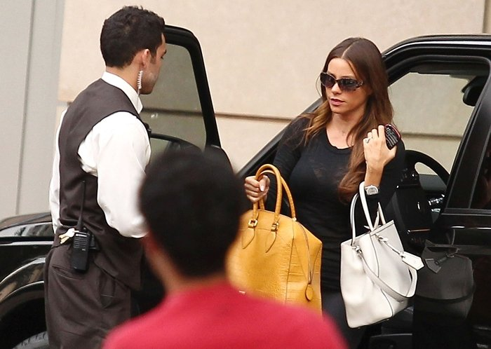 Sofia Vergara going out to dinner in West Hollywood carrying two oversized handbags
