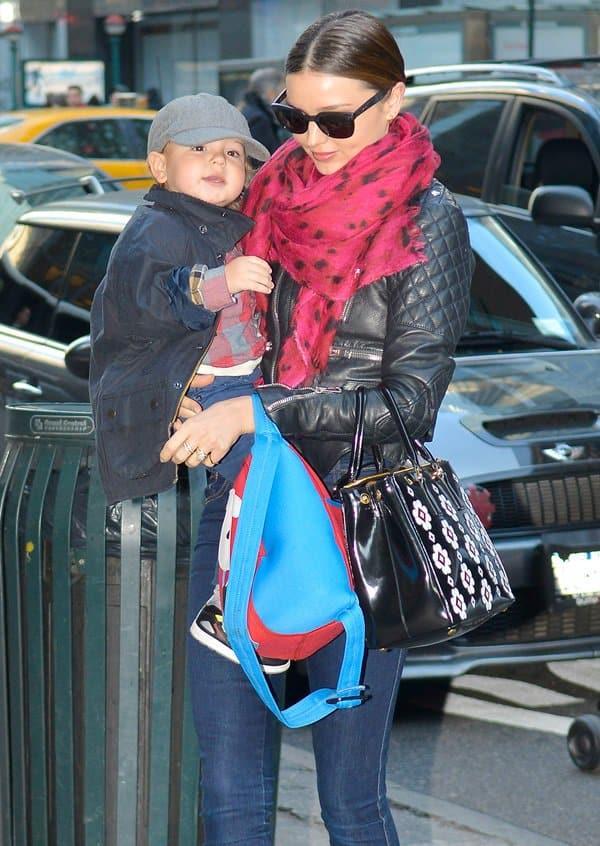 Miranda Kerr and son Flynn heading into an office building