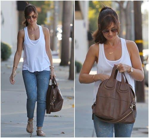 Minka Kelly returning to her car after leaving Salon Benjamin in West Hollywood