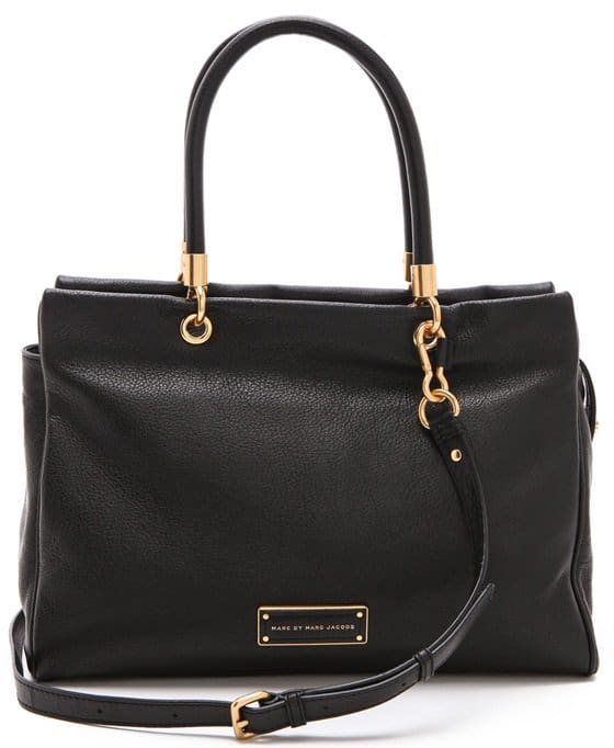 Brushed gold hardware sets off the finely grained Italian leather of a roll-handle tote cut with a clean, crisp topline