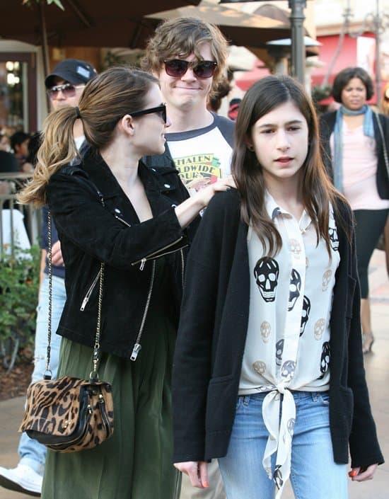 Emma with her boyfriend Evan Peters and her half-sister Grace Nickels
