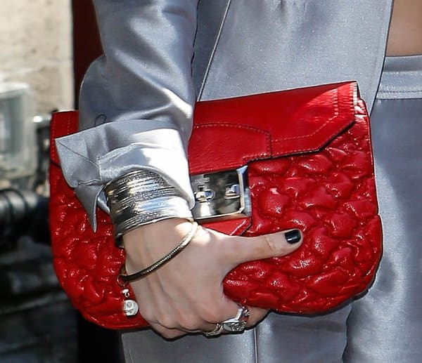 Laura Whitmore's red quilted clutch