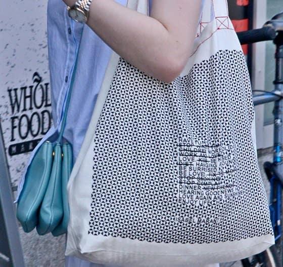 Dakota Fanning's light blue crossbody and market bags