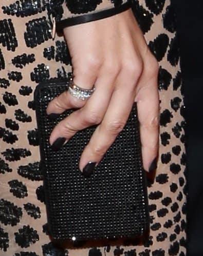 Jennifer Lopez kept everything else understated, including her clutch