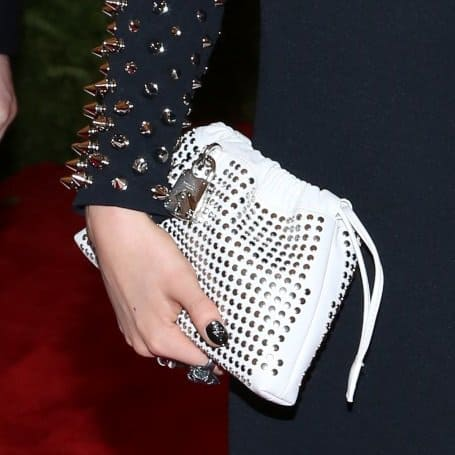 Cara Delevigne's catchy white studded drawstring pouch she used for a clutch