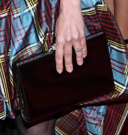 Even her black framed clutch sported a jeweled clasp that was hard to ignore