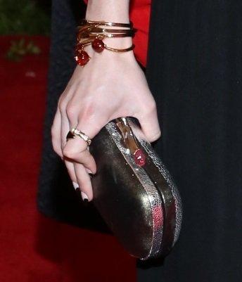 Emma Roberts toting metallic purse