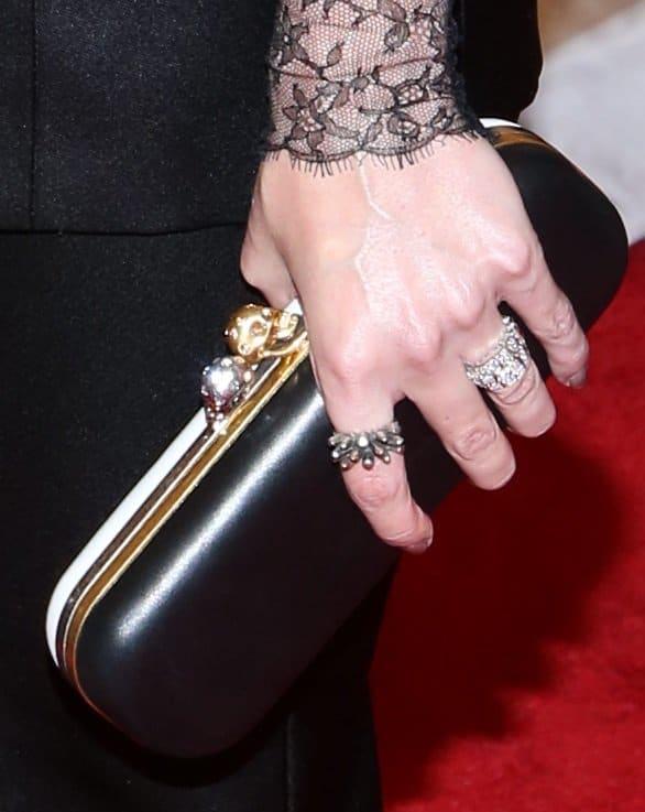 Jaime's clutch is from Alexander McQueen