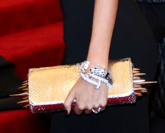 She paired her simple cutout gown with a spiked clutch from Louboutin