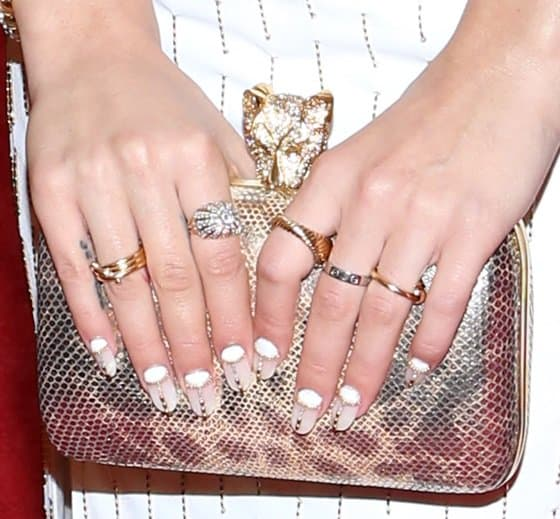 Her purse (and nails), on the other hand, took center stage