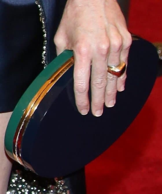 Stella McCartney carried a round plexiglass box clutch from her own collection