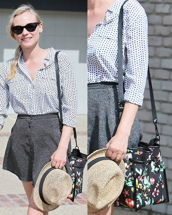 Diane Kruger wearing a star-printed Equipment signature top that she paired with a gray skater mini skirt