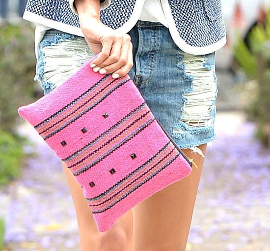 Hot accessory: Jamie Chung's bright pink clutch