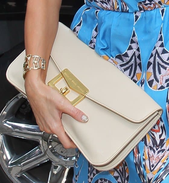 A closer look at the oversized clutch Paris is holding