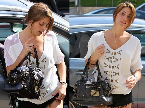 Ashley Greene with her Louis Vuitton 'Rivets' handbag in Los Angeles on July 26, 2013