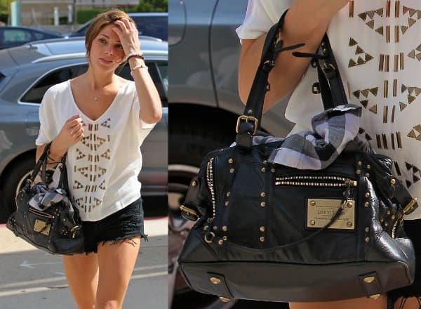 The Louis Vuitton 'Rivets' handbag serving as a great match for Ashley Greene's edgy day look