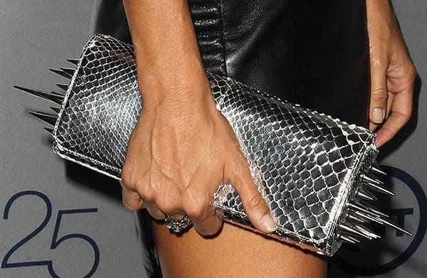Angie Harmon totes spiked Christian Louboutin Marquise clutch