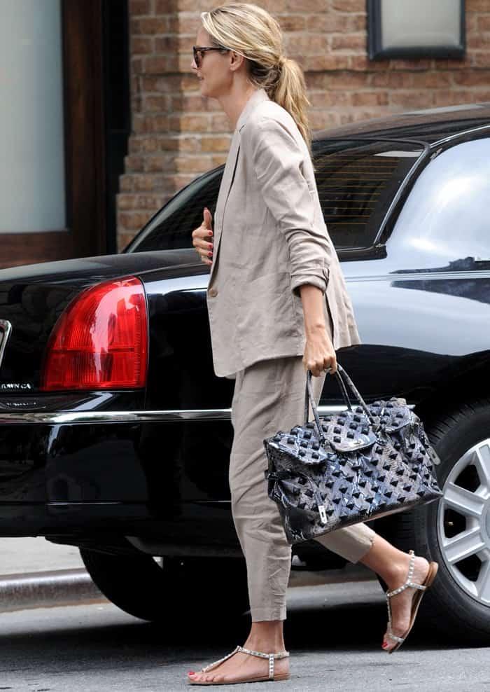 7a4c8a602f Heidi Klum toting a studded snakeskin Birkin as she arrived at her hotel in  Manhattan