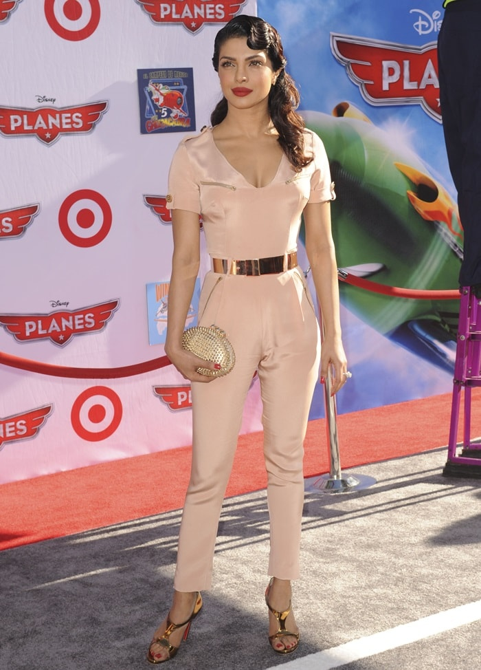 67a38781ce04 ... studded clutch both by Christian Louboutin. Priyanka Chopra in a  form-fitting jumpsuit by Maya Crispin accented with gold-tone