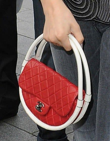 Chloë Moretz toting her Hula Hoop handbag from Chanel