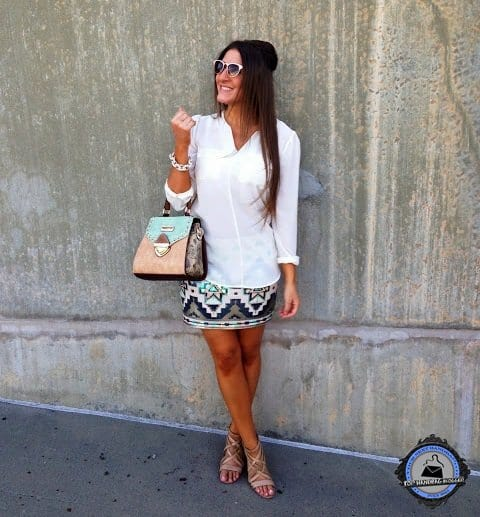 Christina Storm styled her tribal print skirt with a white shirt