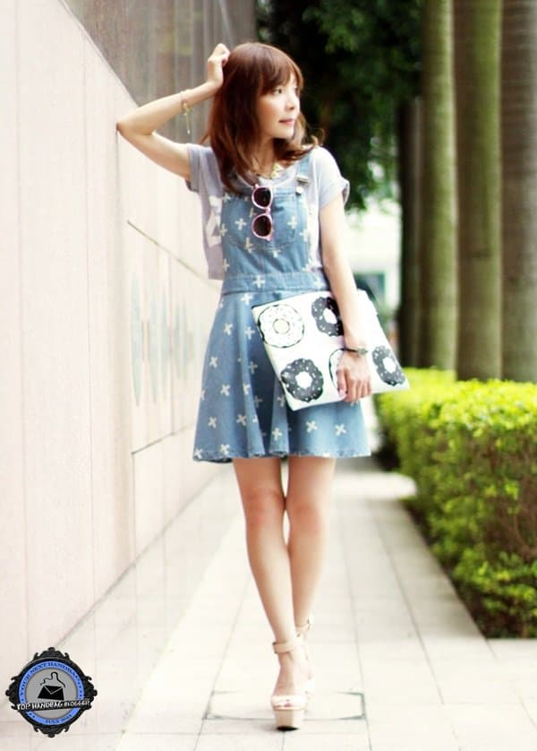Prisca styled her cross-print denim dress with a graphic tee