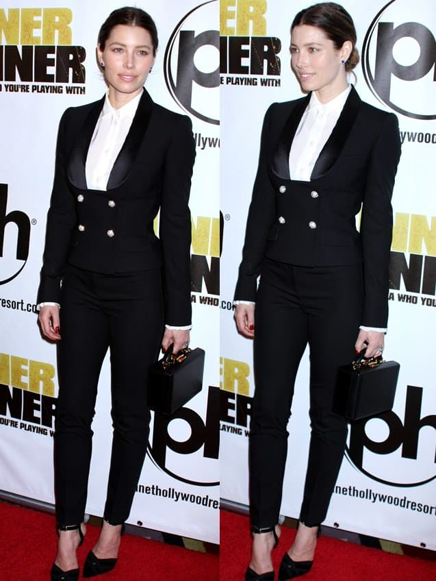 Jessica Biel wearing a Dolce & Gabbana suit with pointed pumps by Giambattista Valli and a box-shaped bag by Mark Cross