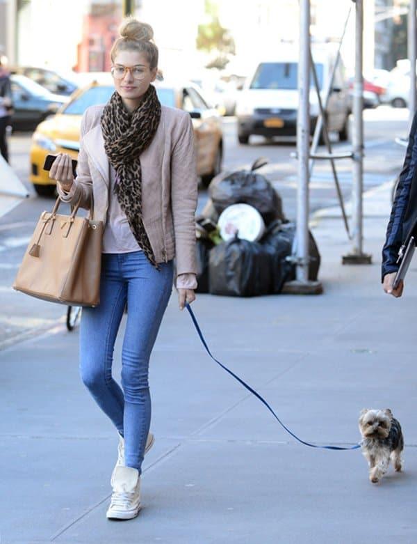 Jessica Hart walking her dog in New York City on September 17, 2013