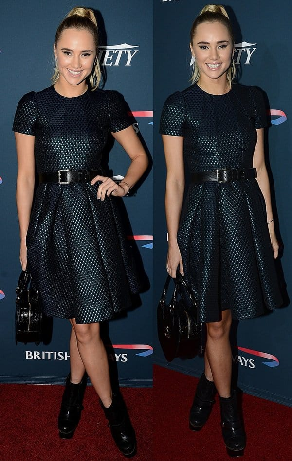 Sukie Waterhouse wore a dark blue fit-and-flare dress from Mulberry's Fall 2013 collection and Vivienne Westwood's snake-print heart handbag