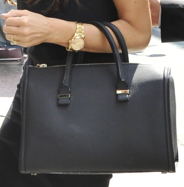 Victoria Beckham carrying a black 'The Victoria' mini matte-leather tote in black