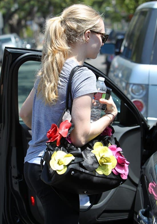 Amanda Seyfried departs a private gym with her personal trainer in Los Angeles, California, on June 14, 2010