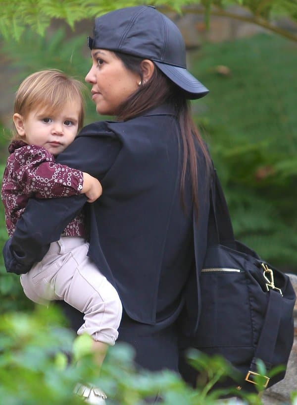 ca90a0231563 Kourtney Kardashian with baby Penelope heading to a baby class in Beverly  Hills. This Prada diaper bag ...