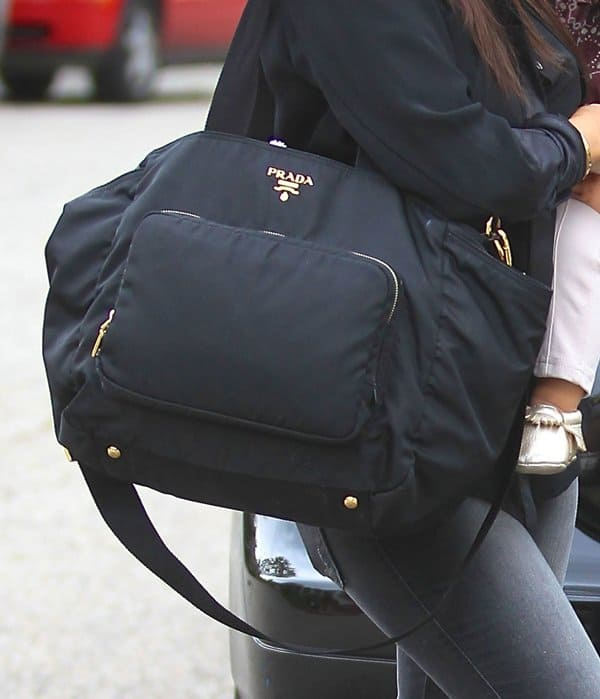 929296346735 This Prada diaper bag that Kourtney is toting costs over  1