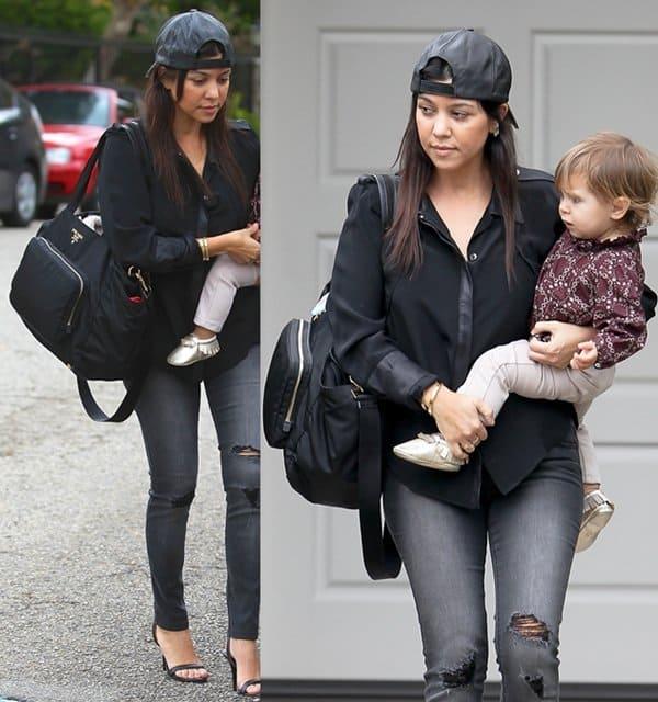 78972c422fa0 ... Prada diaper bag. Kourtney was in tattered jeans with a backward cap Kourtney  Kardashian ...