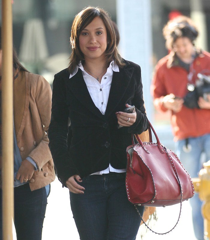 Cheryl Burke toting a fiery red version of the Rockstud dome satchel