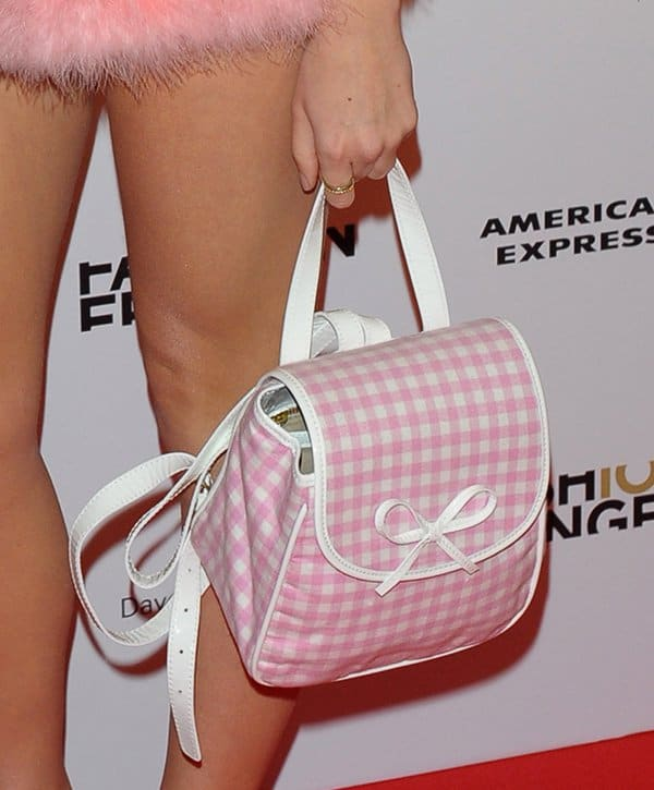 Pixie Lott carrying a Chloe Sevigny for Opening Ceremony gingham backpack