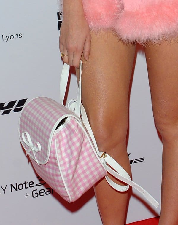 Pixie Lott's backpack features a gingham pattern in pink and white