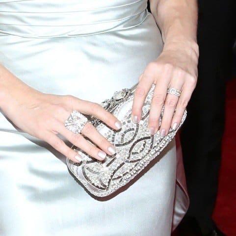 Amy Adams carried a bedazzled Oscar de la Renta Crown Goa clutch
