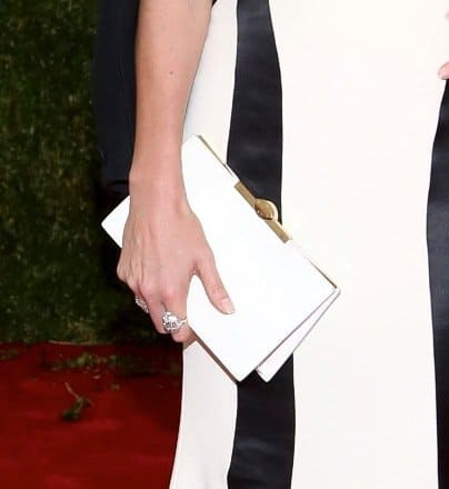 Charlize Theron looked regal in a monochrome Dior Couture gown matched with a Dior satin clutch