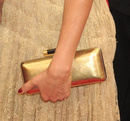 Jessica Alba carried a DVF Sutra clutch that matched the dress perfectly